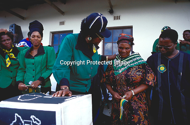 PEMANNW55023.Personality. Winnie Mandela.  Johannesburg, South Africa. She campaigns in support of the ANC. Hers she is seen with fellow ANC supporters.  Wearing ANC's  colours.3/99..©Per-Anders Pettersson /iAfrika Photos