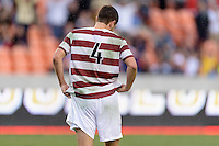 Houston, TX - Friday December 11, 2016: Tomas Hilliard-Arce (4) of the Stanford Cardinal reacts after missing his kick in the overtime shootout against the Wake Forest Demon Deacons at the NCAA Men's Soccer Finals at BBVA Compass Stadium in Houston Texas.
