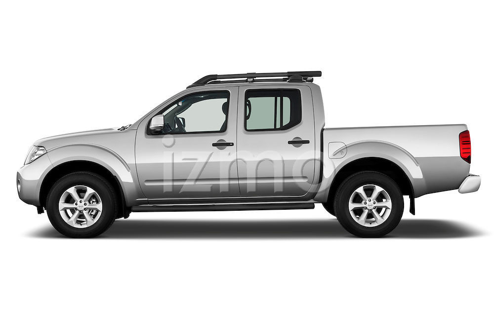 Driver side profile view of a 2010 Nissan Navara LE 4 door Pick-Up Truck.