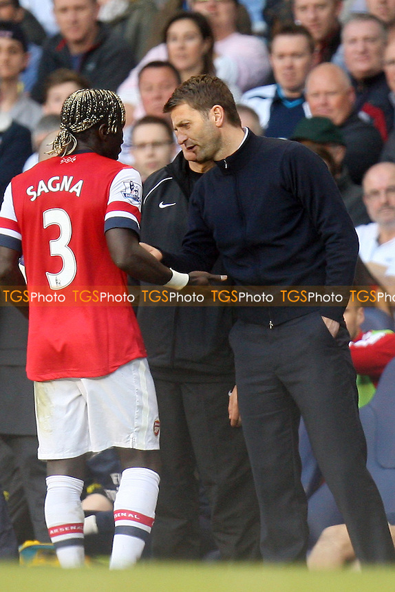 Tottenham Hotspur manager Tim Sherwood speaks with Bacary Sagna of Arsenal - Tottenham Hotspur vs Arsenal, Barclays Premier League Football at the White Hart Lane Stadium - 16/03/14 - MANDATORY CREDIT: Dave Simpson/TGSPHOTO - Self billing applies where appropriate - 0845 094 6026 - contact@tgsphoto.co.uk - NO UNPAID USE