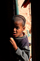 A boy goes into a haima on December 12, 2003, in the Saharawi refugee camps. Saharawi people have been living at the refugee camps of the Algerian desert named Hamada, or desert of the deserts, for more than 30 years now. Saharawi people have suffered the consecuences of European colonialism and the war against occupation by Moroccan forces. Polisario and Moroccan Army are in conflict since 1975 when Hassan II, Moroccan King in 1975, sent more than 250.000 civilians and soldiers to colonize the Western Sahara when Spain left the country. Since 1991 they are in a peace process without any outcome so far. (Ander Gillenea / Bostok Photo)