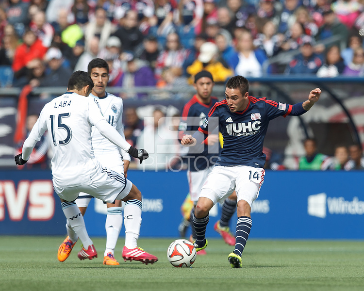 New England Revolution midfielder Diego Fagundez (14) attempts to control the ball. In a Major League Soccer (MLS) match, the New England Revolution (blue/white) tied Vancouver Whitecaps FC (white), 0-0, at Gillette Stadium on March 22, 2014.