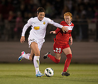 Abby Wambach (20) of the Western NY Flash tries to get past Tori Huster (23) of the Washington Spirit during the game at the Maryland SoccerPlex in Boyds, MD.  Washington tied Western NY, 1-1.
