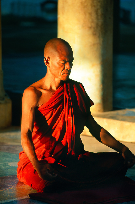 Buddhist monk meditating at Shwezigon Pagoda, Bagan (Pagan), Myanmar (Burma)