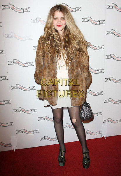 SKY FERREIRA.Odd Molly Flagship Store Opening held At Odd Molly Boutique, Beverly Hills, California, USA, 19th March 2010..full length brown fur coat white cream dress hands in pockets grey gray silver bag ripped tights hole black shoes green platform sandals feet .CAP/ADM/KB.©Kevan Brooks/AdMedia/Capital Pictures.