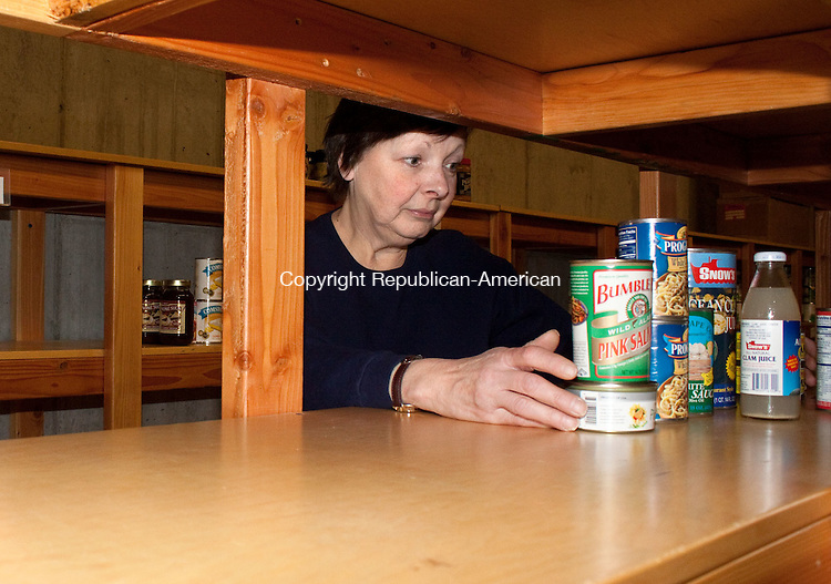 SHELTON CT-09 FEBRUARY 2011 020912DA02 - Food Bank Volunteer Maryann Bonavita organizes what is left on the shelves   were plenty of food once sat at the Spooner House which is operated by Area Congregations Together, Inc. in Shelton. Over the past 20 years this pantry is at its lowest for perishable items on hand, and families in need is at its highest. If you would like to donate there will be a food drive and collection held at Stop & Shop in Ansonia, Seymour and Shelton Saturday from 9:00am-2:00pm.DARLENE DOUTY REPUBLICAN AMERICAN