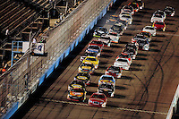 Apr 10, 2008; Avondale, AZ, USA; NASCAR Camping World Series West drivers Ryan Foster (41) and Marc Davis (92) lead the field to the green flag during the Jimmie Johnson Foundation 150 at Phoenix International Raceway. Mandatory Credit: Mark J. Rebilas-