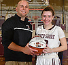 Gabrielle Zaffiro #13, North Shore junior, poses with head coach Keith Freund after the Nassau County varsity girls basketball Class A quarterfinals against Cold Spring Harbor at North Shore High School in Glen Head, NY on Wednesday, Feb. 22, 2017. She recorded her 2,000th career point in the first quarter of the game and scored 34 points in North Shore's 74-46 win.