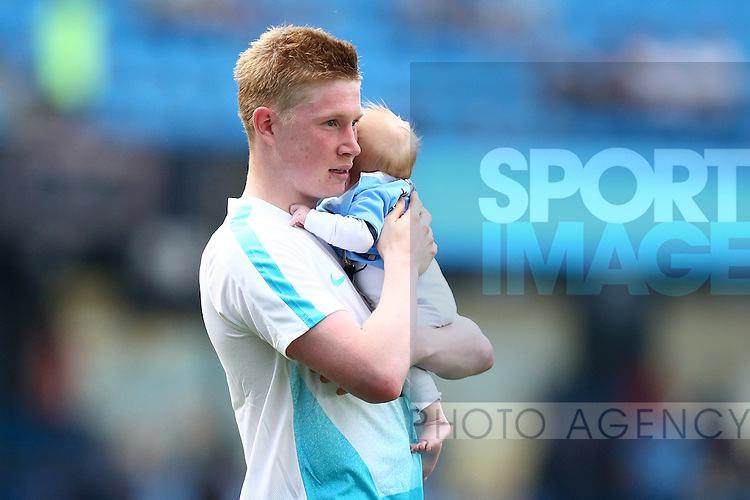 Kevin De Bruyne of Manchester City with his son during the lap of appreciation during the Barclays Premier League match at the Etihad Stadium. Photo credit should read: Philip Oldham/Sportimage