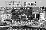 1 April 2013: Washington Nationals outfielder Bryce Harper appears on the video scoreboard screen as he accepts the Jackie Robinson Award for the 2012 National League Rookie of the Year from Washington Nationals General Manager Mike Rizzo prior to the Opening Day Game between the Miami Marlins and the Washington Nationals at Nationals Park in Washington, DC. The Nationals shut out the Marlins 2-0 to launch the 2013 season. Mandatory Credit: Ed Wolfstein Photo *** RAW (NEF) Image File Available ***