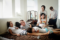 A group of gay and lesbian friends and partners, all LGBT activists, relax together. L-R: Yana Petrova, Pavel Lebedev, Elena Davydova (resting her head on Yana's legs), Ilmira Shayhraznova (standing), Elena Yakovleva and Kirill Kalugin (in the background). On 30 June 2013, Russian President Vladimir Putin signed into law an ambiguous bill banning the 'propaganda of nontraditional sexual relations to minors'. The law met with widespread condemnation from human rights and LGBT groups. (MANDATORY CREDIT   photo: Mads Nissen/Panos Pictures /Felix Features)