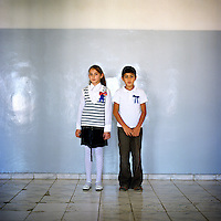 Dadamyan Michael and Ann Kayriyan, 10 years old, from the School number 7 after Eghishe .Charents ( a famous Armenian poet) in Stepanakert. Ann's father was an active fighter participated in the conflict since he was 16 years old. Her father didn't say anything to her about that time and his experience but she already knows the history of Karabakh, her mother told her everything..Michael's grandfather was also involved during the liberation. But his father was only 15 at that .time and he had to lye not to participate to the war because he was too young and without any .experience..