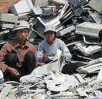 Migrant workers sort scraps of old computers and electronic trash in Guiyu, China March 8, 2006. For years, developed countries have been exporting tons of electronic waste to China for inexpensive, labor-intensive recycling and disposal. Since 2000, it's been illegal to import electronic waste into China for this kind of environmentally unsound recycling. But tons of debris are smuggled in with legitimate imports, corruption is common among local officials, and China's appetite for scrap is so enormous that the shipments just keep on coming...