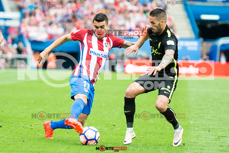"Atletico de Madrid's player Ángel Martín Correa and Sporting de Gijon's Manuel ""Lillo"" Castellano during a match of La Liga Santander at Vicente Calderon Stadium in Madrid. September 17, Spain. 2016. (ALTERPHOTOS/BorjaB.Hojas) /NORTEPHOTO"