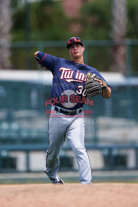 GCL Twins third baseman Jose Miranda (30) throws to first during a game against the GCL Orioles on August 11, 2016 at the Ed Smith Stadium in Sarasota, Florida.  GCL Twins defeated GCL Orioles 4-3.  (Mike Janes/Four Seam Images)