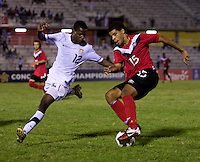 Joseph Amon (12) of the United States tries to stop Jordan Hamilton (15) of Canada during the finals of the CONCACAF Men's Under 17 Championship at Catherine Hall Stadium in Montego Bay, Jamaica. The United States defeated Canada, 3-0, in overtime
