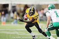 October 31, 2009; Hamilton, ON, CAN;  Hamilton Tiger-Cats running back DeAndra' Cobb (14). CFL football: Saskatchewan Roughriders vs. Hamilton Tiger-Cats at Ivor Wynne Stadium. The Tiger-Cats defeated the Roughriders 24-6. Mandatory Credit: Ron Scheffler. Copyright (c) 2009 Ron Scheffler.