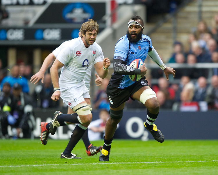 Api Naikatini of the Flying Fijians breaks past Geoff Parling of England during the QBE International between England and Fiji at Twickenham on Saturday 10th November 2012 (Photo by Rob Munro)