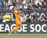 Houston Dynamo forward Cam Weaver (15) running chest trap.  In a Major League Soccer (MLS) match, Houston Dynamo (orange) defeated the New England Revolution (blue), 2-1, at Gillette Stadium on July 13, 2013.