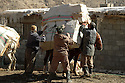 Iraq 2008.Kurdish smugglers loading an horse in Zahle <br />