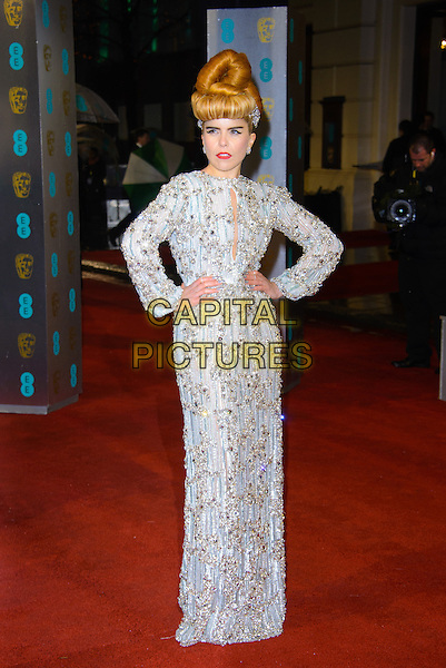 Paloma Faith.EE British Academy Film Awards at The Royal Opera House, London, England 10th February 2013.BAFTA BAFTAS arrivals full length dress white silver grey gray gold beads beaded hands on hips long sleeves cut out away hair up  embellished jewel encrusted.CAP/CJ.©Chris Joseph/Capital Pictures