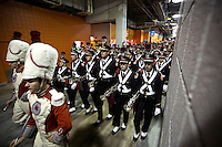 The Ohio State Marching Band makes their way through Sun Life Stadium before the Discover Orange Bowl between Ohio State and Clemson in Miami Gardens, Florida, Friday evening, January 3, 2014. (The Columbus Dispatch / Eamon Queeney)