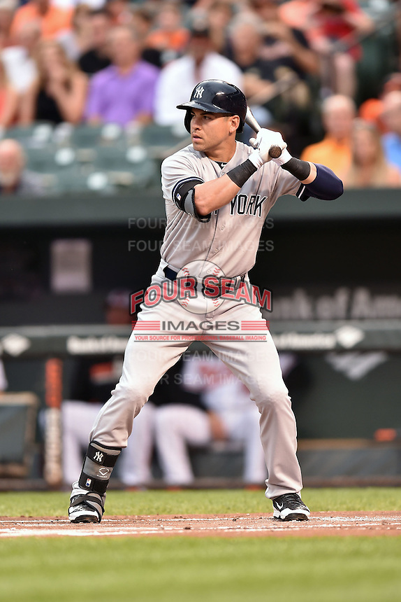 New York Yankees center fielder Jacoby Ellsbury #22  awaits a pitch during a game against the Baltimore Orioles at Oriole Park at Camden Yards August 11, 2014 in Baltimore, Maryland. The Orioles defeated the Yankees 11-3. (Tony Farlow/Four Seam Images)