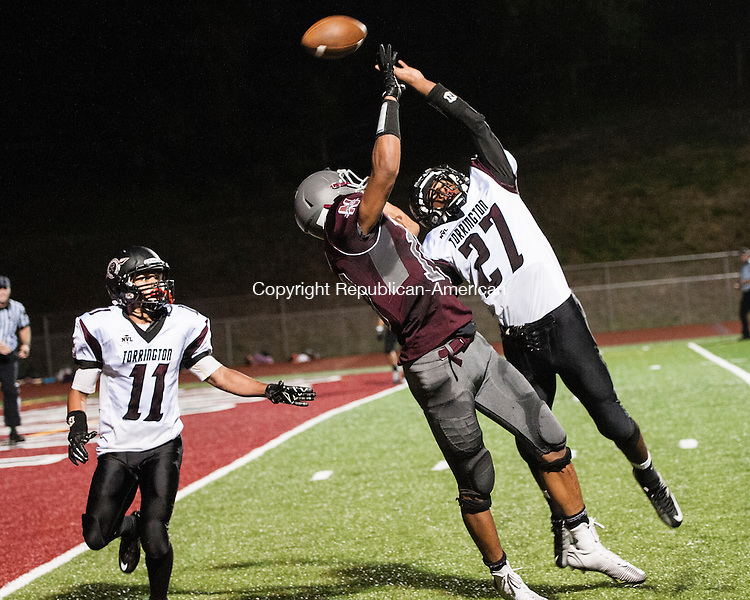 NAUGATUCK, CT-12 September 2014-091214EC22-  A pass meant for Naugatuck's Chris Quarles is broken up by Torrington's Ignacio Reynoso Friday night. The Raider's (11) is Frank Perry. Erin Covey Republican-American