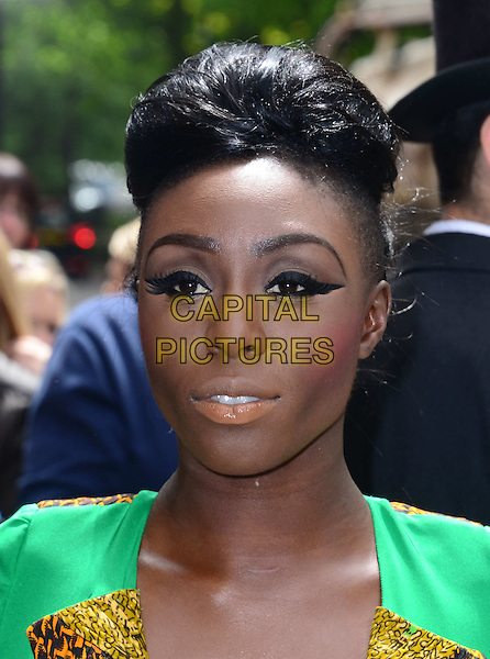 LONDON, ENGLAND - MAY 22:   Laura Mvula attends The Ivor Novello Awards, the 59th annual songwriting and composing awards, at Grosvenor House, 86-90 Park Lane, on May 22, 2014, in London, England.<br /> <br /> CAP/JOR<br /> &copy;Nils Jorgensen/Capital Pictures