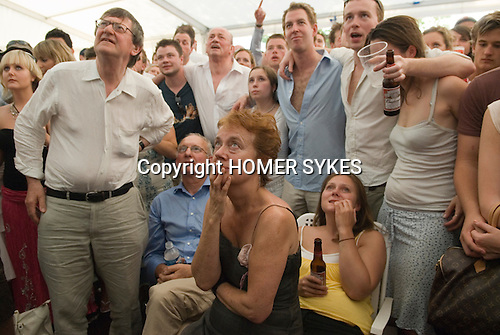 The World Cup. England v Portugal. The  penalty shoot out England went on to lose.  Henley Royal Regatta, Henley on Thames, Oxfordshire, England. 2006 Fans photographed in beer tent marquee watching the football game on specially erected televisions sets.