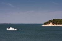 Large yacht cruising on Lake Texoma, Texas.