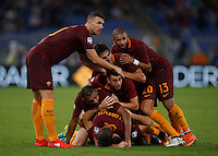 Calcio, Serie A: Roma vs Inter. Roma, stadio Olimpico, 2 ottobre 2016.<br /> Roma&rsquo;s Kostas Manolas, bottom, is hidden by his teammates' hugs after scoring the winning goal during the Italian Serie A football match between Roma and FC Inter at Rome's Olympic stadium, 2 October 2016. Roma won 2-1.<br /> UPDATE IMAGES PRESS/Isabella Bonotto