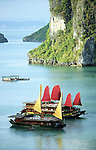 Halong Bay Sails 02 - Tourist junk cruise boats with red and yellow sails, Halong Bay, Viet Nam