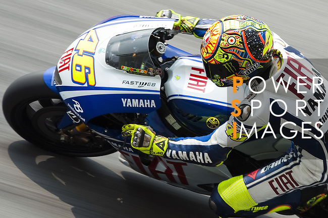 Valentino Rossi of Italy rides the #46 Fiat Yamaha Team Yamaha during qualifying practice for the Malaysian MotoGP, which is round 16 of the MotoGP World Championship at the Sepang Circuit on October 24, 2009 in Kuala Lumpur, Malaysia.  Photo by Victor Fraile / The Power of Sport Images