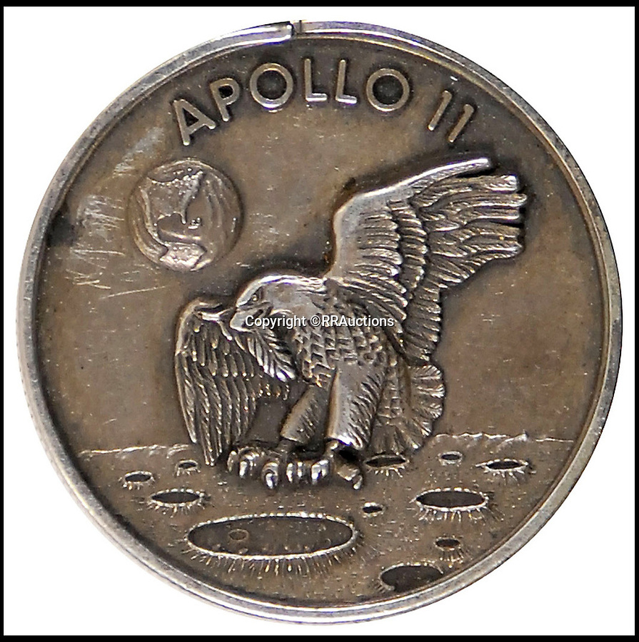 BNPS.co.uk (01202 558833)<br /> Pic : RRAuctions/BNPS<br /> <br /> Neil Armstrong's Apollo 11 Robbins Medal, est. £48,000.<br /> <br /> One small step-by-step for man...<br /> <br /> Fascinating step-by-step plan of the historic first moon landing reveals NASA's meticulous planning. <br /> <br /> A collection of rare artefacts from the Apollo 11 mission are being sold on the 50th anniversary of the historic moon landings.<br /> <br /> The sale also includes an American flag carried to the moon, Neil Armstrong's toy plane that first inspired him to fly, along with his Robbins medal and the visitors book from Airforce One with comments from the astronauts and their wives.<br /> <br /> The items are going under the hammer with US based RR Auctions who expect them to fetch over £127,000. ($160,000)