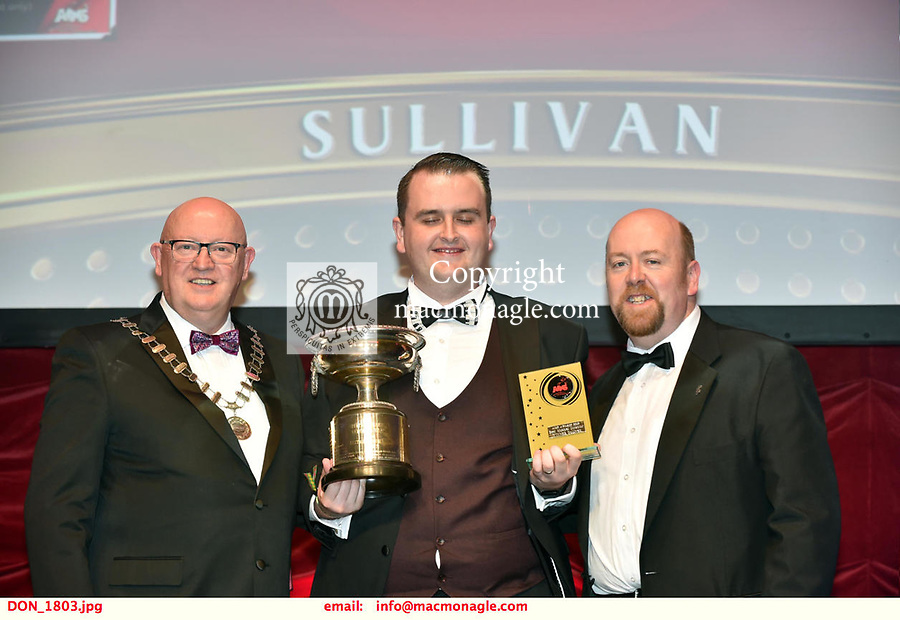 16-6-2019:  Shane Farrell- Jesus Christ Superstar- Castlerea Musical Society, Galway winner of the Best Musical Director award at the annual AIMS (Association of Irish Musical Societies) in the INEC Killarney at the weekend receiving the trophy from Seamus Power, President, AIMS left and Rob Donnelly, Vice-President.<br /> Photo: Don MacMonagle - macmonagle.com<br /> <br /> repro free photo from AIMS<br /> <br /> AIMS PRESS RELEASE: There was plenty of glitz and glamour in Killarney on Saturday night as The Association of Irish Musical Societies has its Annual Awards Ceremony in Killarney. Over 1,500 people could be heard over the Kerry mountains as the winners were announced by MC Fergal D'Arcy. Many societies were double winners on the night including UCD Musical Society, Dublin were dancing all the way to the trophies winning Best Choreography and Best Choreographer for Leah Meagher for Cabaret and  Tullamore Musical Society who took their moment as Chris Corroon won Best Male Singer for his sinful performance as Henry Jekyll in Jekyll &Hyde and also Director Paul Norton who'd plenty to celebrate picking Best Director for  the same show. The moment was once again taken by Jekyll&Hyde by Dùn Laoighaire Musical&Dramatic Society as Kevin Hartnett took up Best Male Singer in the Sullivan category.Nenagh Youth Musical Society raised their voices high and took home Best Ensemble. It was a superior night for Enniscorthy Musical Society by winning Best Comedienne for Jennifer Byrne as Mother Superior and Best Technical too. Portlaoise Musical Society rose to the top by taking home Best Overall Show in the Gilbert section for their stunning production of Titanic. Oyster Lane Theatre Group, Wexford flew their flag high taking home Best Overall Show in the Sullivan Section for their breathtaking production of Michael Collins-a Musical Drama.<br /> Other winners on the night included Best Comedian for Ronan Walsh as Officer Lockstock in Urinetown for Trim Musical Society, Be