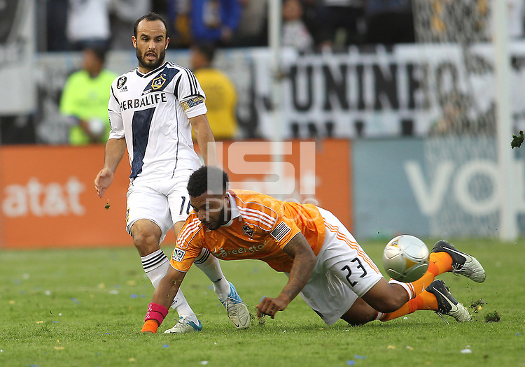 CARSON, CA - DECEMBER 01, 2012:   Landon Donovan (10) of the Los Angeles Galaxy clashes with Giles Barnes (23) of the Houston Dynamo during the 2012 MLS Cup at the Home Depot Center, in Carson, California on December 01, 2012. The Galaxy won 3-1.