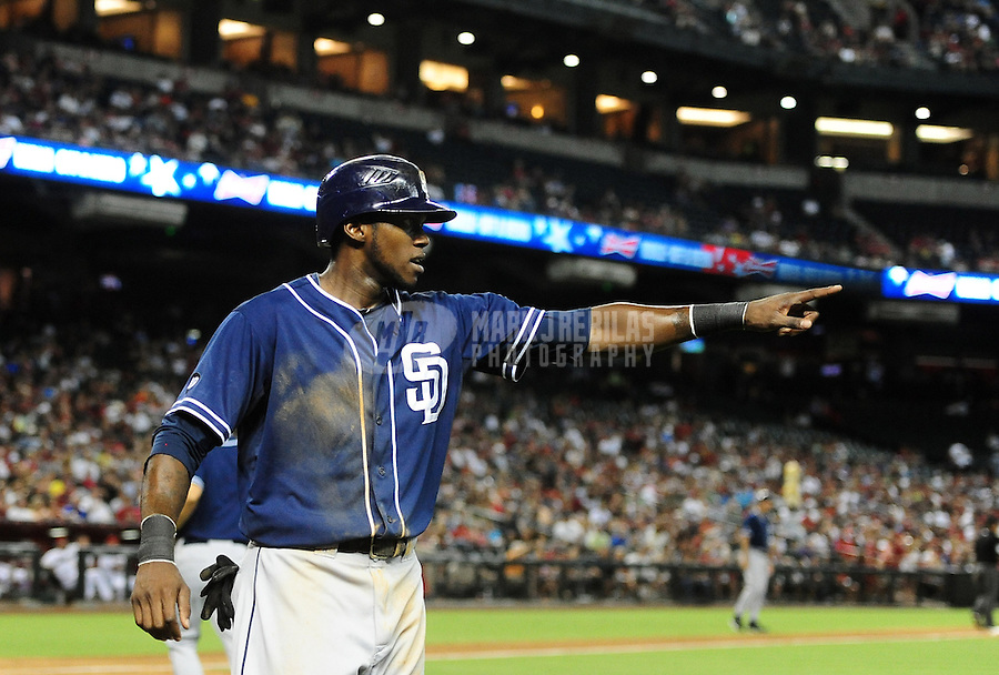 Jul. 3, 2012; Phoenix, AZ, USA: San Diego Padres outfielder Cameron Maybin celebrates after scoring in the fourth inning against the Arizona Diamondbacks at Chase Field. Mandatory Credit: Mark J. Rebilas-