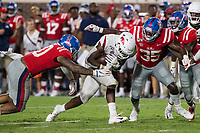 NWA Democrat-Gazette/BEN GOFF @NWABENGOFF<br /> Treylon Burks, Arkansas wide receiver, braces as Jacquez Jones (left) and Donta Evans, Ole Miss linebackers, move in for the tackle in the fourth quarter Saturday, Sept. 7, 2019, at Vaught-Hemingway Stadium in Oxford, Miss.