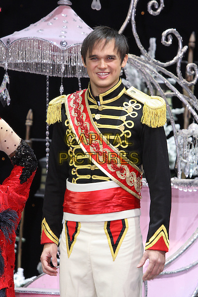 GARETH GATES.First Family Entertainment 2011 Pantomimes Photocall at the Piccadilly Theatre, London, November 26th 2010..panto costume half length red sash prince jacket gold uniform .CAP/JIL.©Jill Mayhew/Capital Pictures