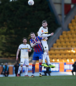 24th March 2018, McDiarmid Park, Perth, Scotland; Scottish Football Challenge Cup Final, Dumbarton versus Inverness Caledonian Thistle; Kyle Hutton of Dumbarton outjumps Liam Polworth of Inverness Caledonian Thistle to win a header