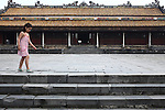 A girl walks along a set of steps leading to the Palace of Supreme Harmony inside the Citadel in the former imperial capital of Hue, Vietnam. April 21, 2013.