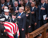 Dignitaries pay their respects as the casket containing the remains of the late former United States President George H.W. Bush at the National funeral service in his honor at the Washington National Cathedral in Washington, DC on Wednesday, December 5, 2018.  Front row: United States President Donald J. Trump, first lady Melania Trump, former US President Barack Obama, and former US President Bill Clinton. Second row: former US Vice President Dan Quayle and Marilyn Quayle. <br /> Credit: Ron Sachs / CNP<br /> (RESTRICTION: NO New York or New Jersey Newspapers or newspapers within a 75 mile radius of New York City)