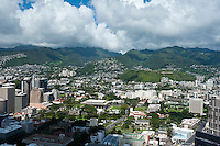 Downtown Honolulu aerial with state capital and mountains