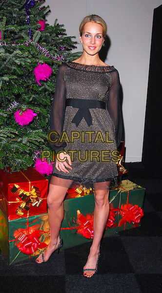 LADY ISABELLA HERVEY.At the Capital Rocks! Party, .Battersea Park Events Arena, London, .England, December 12th 2006..full  length black gold sheer dress sleeves bow.CAP/CAN.©Can Nguyen/Capital Pictures