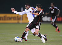 DC United forward Jaime Moreno (99) fights for possession of the ball against Kansas City midfielder Craig Rocastle (4). DC United defeated The Kansas City Wizards  2-0 at RFK Stadium, Wednesday May 5, 2010.