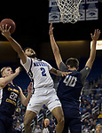 Nevada guard Jalen Harris (2) shoots over Colorado Christian center Spencer Hoffman (40) during the first half of an NCAA college basketball game in Reno, Nev., Wednesday, Oct. 30, 2019.