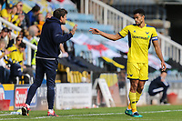 Curtis Nelson of Oxford United (right) gets instructions from Pep Clotet (Manager) of Oxford United during a break in play during the Sky Bet League 1 match between Peterborough and Oxford United at the ABAX Stadium, London Road, Peterborough, England on 30 September 2017. Photo by David Horn.