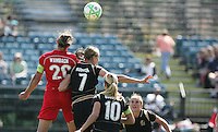 Abby Wambach (20) heads the ball over Leigh Ann Robinson (7), Leslie Osborne (10) and Rachel Buehler (right). Washington Freedom defeated FC Gold Pride 4-3 at Buck Shaw Stadium in Santa Clara, California on April 26, 2009.