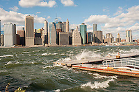 The windy, choppy waters of the East River break against a breakwater in Brooklyn Bridge Park in New York on Sunday, October 23, 2016. Wind gusts reached 55 mph with the city issuing a wind advisory. Monday is expected to be warmer with less wind. (© Richard B. Levine)